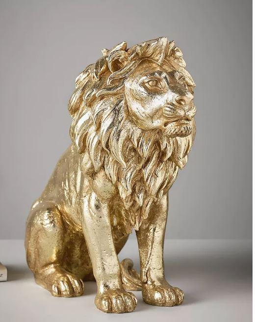 Kultainen leijonapatsas
